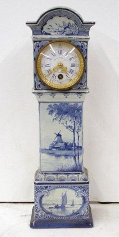 "Delft Pottery Mantle Clock, 15 1/2"" tall case form mantle clock, time movement, painted porcelain enamel dial marked Bosch Honig & Cie, Utrecht. The clock has crazing, the works are intact but movement is not observed."