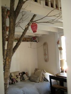 Jess Brown (creator of her eponymous Rag Dolls as well as a new line of women's clothing) created this room for her daughter Stella, using a salvaged tree trunk as bed canopy.