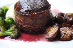 Bacon Wrapped Filet Mignon, Caramelized Crimini Mushrooms, Sauteed Broccoli, and Red Wine Reduction