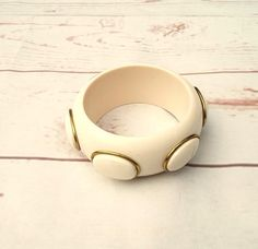 Vintage statement mod bangle  A chunky plastic bracelet which feels quite heavy and lovely quality  There are no joins in the plastic  It has some minor pink markings around the rim but you need to be looking to see them  Circa 1970s  Please find other jewellery items here https://www.etsy.com/shop/foxvintageuk?section_id=21660707  And find mod vintage dresses here https://www.etsy.com/shop/foxvintageuk?section_id=17453856