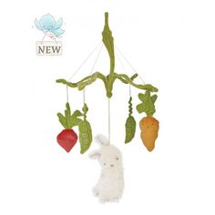This delightful mobile from the Good Friends Garden is a wonderful addition to baby's room. Dangling from soft carrot-top leaves are sweet peas, a carrot, a radish and a furry bunny.