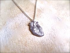 tiny anatomical human heart necklace. $8.00, via TheTamerlane on Etsy.