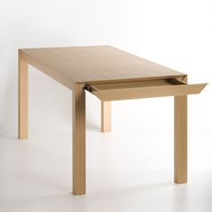 """NOSIGNER designed Imaginary is a table that refers to the mathematical term of """"imaginary number."""" It includes an invisible drawer that allows a place to hide away cutlery and documents. http://nosigner.com/ja/case/imaginary/"""
