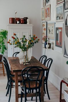 Dining Room decor ideas - modern contemporary style with natural wood open beam ceiling, double tables on casters, and leather parsons chairs set off with vibrant art | #scandinavian #diningroomdesign #diningroomdecorideas #diningroomdesign #diningroomlighting #diningroomchandelier #moderndiningroom #contemporarydiningroom