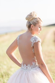 The back of this YSA Makino beach wedding dress is gorgeous! I love the lace and bead details!