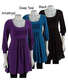 Short dress features empire waist with flattering gatherings. Tunic dress has a rounded neckline. Long-sleeve dress hangs perfectly on any figure