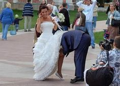 funny wedding pictures, groom taking off brides garder