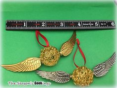 Golden Snitch Christmas Ornament inspired by by TheSeasonsGeekings