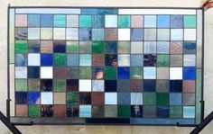 Stained glass panel featuring sea glass and a variety of clear textured glass