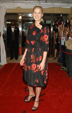 Pin for Later: From Bond Girl to Gone Girl: Rosamund Pike's Red Carpet Evolution Rosamund Pike Taking Pride & Prejudice to the Toronto Film Festival in 2005, Rosamund slipped into a fussy red and black floral dress.