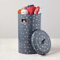 Our new floor storage bin features metallic polka dots, and a vintage-inspired profile.