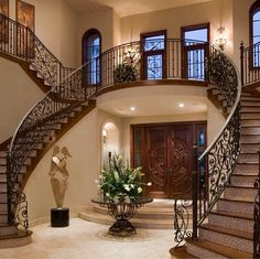 Beautiful Foyer with double stairs.