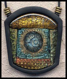 pendant by Susan Waddington of Polydogz Designs    http://polydogz.com/Gallery1/Polymer-jewelry/4_G_001