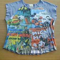 CLEARANCE CLEARANCE CLEARANCE Cute comic strip of Micky's best films. Has stain on back shown in pic. Disney Tops