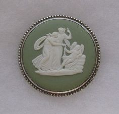 A lovely vintage green Jasperware Wedgwood Cameo Brooch in a Silver frame which is signed on the reverse 'Silver FAW'.