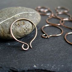 Copper Hoop Earwires. Using a different metal type with your ear wires can offer new design options for your pieces. In this pair, pure copper is shaped into a small hoop wire and lightly oxidized and filed at the ends for a smooth comfort finish.