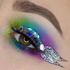 """Watch out, Ariel, there's a new fish in town! @phunky_town gives, """"looking fishy"""" a whole new meaning with this stunning look featuring #sugarpill Acidberry, Kim Chi, Velocity and Poison Plum shadows and @litcosmetics glitters, including their new Disco Dots as fish scales! #mermaid #glitter"""