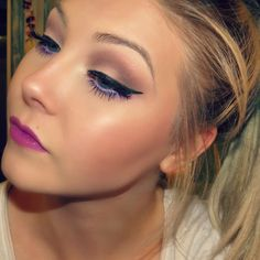 Look I created using MAC Heroine lipstick. I also used the LORAC Gold Unzipped palette. For the purple under the eyes I used BH Eyes On the 60's palette. Liner is MAC fluid line in black track. Brows are Anastasia Beverly Hills DipBrow pomade in Taupe.