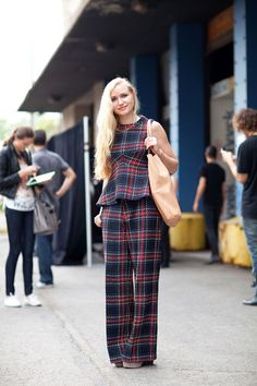 STREET STYLE SPRING 2013: NYFW - Plaid on plaid looks modern with peplum detail. #nyfw