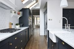I like the dark under counter cabinets and the light marble. Pantry Blue Shaker cabinets mixed with our Bella Brass knobs and handles and beautiful Carrara marble worktops _ Blue Shaker Kitchen, Navy Kitchen, Big Kitchen, Kitchen Dining, Kitchen Cabinets, Shaker Cabinets, Kitchen Ideas, Kitchen Decor, Devol Kitchens