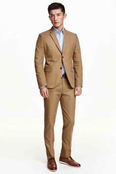 Suit pants in washed cotton canvas. Side pockets, welt back pockets with button, hook-and-eye fastener, and slim, slightly shorter legs. Trouser Suits, Trousers, Pantalon Costume, Cotton Suit, Short Legs, H&m Online, Suit Jacket, Suit Pants, Kids Fashion