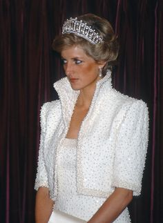 Pairing the Cambridge Lover's Knot tiara with a bejeweled Catherine Walker ensemble in Hong Kong