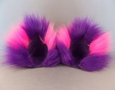 This pair is based on the colors of the Cheshire Cat in the cartoon. They are very fluffy and about 4 tall and 4 wide.    The tail is 22 long and