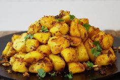 Potatoes - the best ever Indian Spiced Roasties. The perfect partner for any curry recipe or to spice up your Sunday Roast!Bombay Potatoes - the best ever Indian Spiced Roasties. The perfect partner for any curry recipe or to spice up your Sunday Roast! Vegetarian Curry, Vegetarian Recipes, Cooking Recipes, Healthy Recipes, Vegan Curry, Cooking Fish, Indian Food Recipes, Asian Recipes, Ethnic Recipes