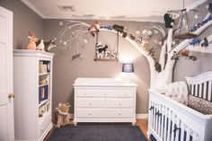 Woodland Nursery featuring a custom built tree filled with furry woodland creatures!