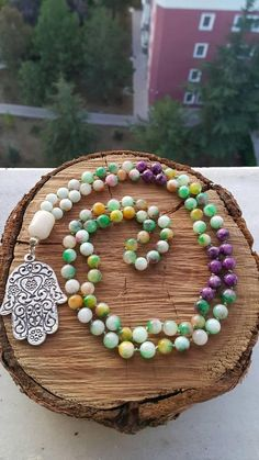 This mala necklace is made of 99 pieces; includes 2 different type of natural gemstones. 8 mm rainbow agate 8 mm purple agate. We can design it as a 108 beads mala necklace or 99 beads islamic tasbih. ABOUT Jewelry Designer of Emotional Dreams offers an exciting collection,