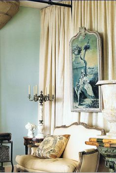 Blue toned 18th century painting, set on burlap drapes, on blue walls in a loft decorated by Michelle Nussbaumer Domestic Art: Curated Interiors Holly Moore