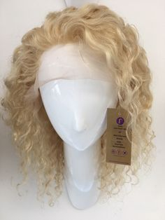 Experience the beauty of our colored lace front wigs! They are available online and in our showroom.