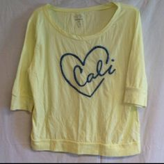 {5/$25} Old Navy Cali Top Cute old navy California yellow top. Has a blue heart with the word cali inside. Never worn. Size Large. Has 3/4 sleeves as well. {REDUCED 2/27/16} Old Navy Tops Tees - Long Sleeve