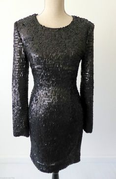 Project D Dress Black Size 8 US 4 Short Cocktail With Long Sleeves | eBay Project D  black dress.  This is a uniquely styled dress.  It is fully covered with small black/grey tabs which give the dress a lovely sheen. It has a round neck and long sleeves.  There is a hidden back zip and is fully lined. It is a UK 8.   There is some stretch.