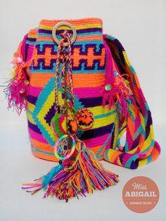 Colorful adorned wayuu mochila
