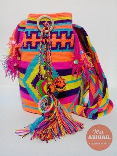 Colorful adorned wayuu mochila