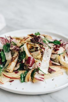 This roasted fennel salad with apples and radicchio is a bright, nutritious, fall salad recipe. It's sweet and nutty, hearty and satisfying. Perfect for a light vegetarian lunch or Thanksgiving salad side dish.