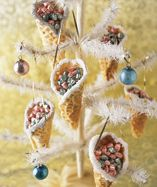 Decorated and filled with treats, these nostalgic cones spread sweet holiday cheer. To simplify assembly, stand each cone in a muffin tin or small glass while filling. Timesaver: Substitute ready-made sugar or waffle cones for the pizzelle. Decorate ...