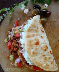 Greek Taco - Ground Lamb (or Turkey) with Mint Tzatziki and Tomato-Cucumber Relish on Grilled Pita. Needed something extra. Sauce was missing something.