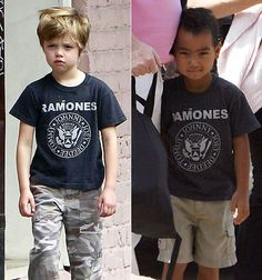 Shiloh Jolie-Pitt Wears Maddox's Hand-Me-Downs - Again! This little girl always dresses like a boy. Oh no, maybe she thinks she was born in the wrong body. :0(