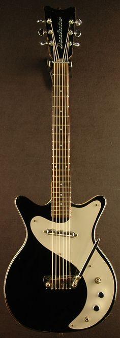 1959 Vintage Danelectro 4011 Guitar ~Hand Vibrato (note the soft V headstock and chrome emblem)  Awesome Photo!