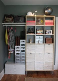 So this is neat -- start with a tall shelf and hang the rods from it to the wall....similar to what we did in Ella's closet (but you wouldn't need an actual closet). You could potentially do it really long and hang one of those second rods from the first.