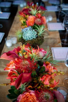 DYING over this arrangement of amazing color, air plants, and succulents. #weddingflowers #airplants