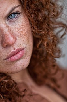 Beautiful red hair and freckles.  #freckles #red hair #blue eyes