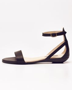 Minimalist and classic, this leather sandal helps you move through life with ease.Flattering lines and effortless style will turn this classic into an essential.   3/4 inch wedge heel  Lined in soft leather  Cushioned insole for maximum comfort and support  Onestrap buckle around the ankle  Bronze buckles  Handmade in Peru  Fits true to size.