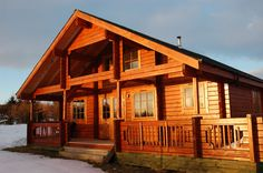 Warm up in a comfortable lodge with tall ceilings and an adorable upper floor Big Sky Lodge, Log Cabin Floor Plans, Log Cabin Homes, Log Cabins, External Doors, Roof Structure, Tall Ceilings, House Built, Cladding