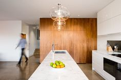 Renovation: A Breezy Modern Addition Opens Up a Historic Melbourne Home - Photo 4 of 7 - The feature lighting consists of incandescent bulbs encased in clear glass. Its brightness is complemented by spot lighting located along the room's perimeter.