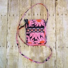 """💕Just In💕Vera Bradley Crossbody Bag 6"""" wide. 8"""" tall. Strap is 30"""". It has a pouch on one side and a zippered pocket on the other. It velcros closed. Has a place for your drivers license. 2 side pouches on the inside. Excellent condition. Non smoking home. Vera Bradley Bags Crossbody Bags"""