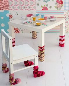 This is not one I would have ever come up with myself. But I like it. Take a plain table and chairs set and dress it up.