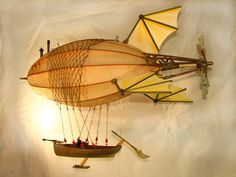 My own steampunk airship Anastasia. Handcrafted from papier-mache and recycled/re-purposed paper, plastic, wood and metal objects. 2.5ft long. Available for sale at http://www.artsmithcraftworks.com/